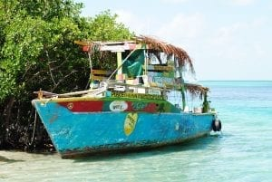 Old boat in the blue shallows of Belize