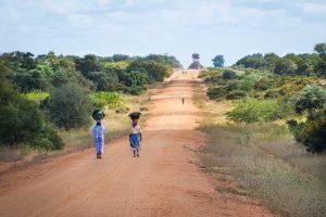 African women walking down the road