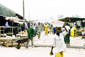 Woman carrying her market purchases on her head in Sierra Leone