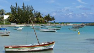 Cap Malheureux, small boats moored up on a tranquil Indian Ocean cove in Mauritius