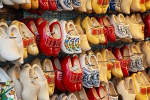 rows of brightly colored clogs for sale