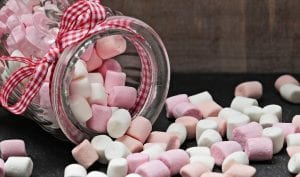 marshmallow candy spilling out of a turned up jar