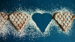 heart shaped waffles, coated in icing sugar