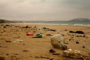 A beach littered with washed up plastic rubbish