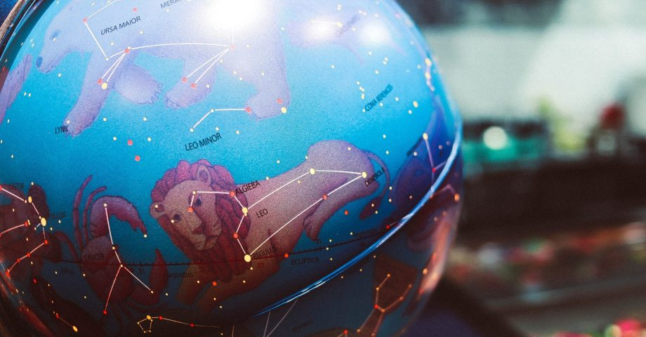 image of a globe with zodiac sign constellations
