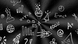 A blackboard with lots of mathematical equations and symbols