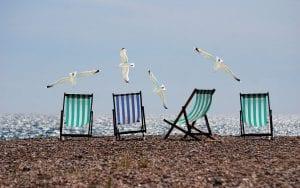 Empty deckchairs on an empty beach