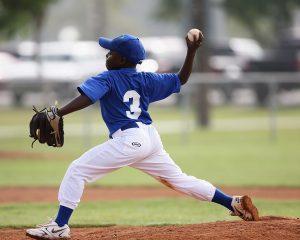 young man playing baseball