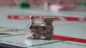 A Monopoly board with the 'train' user