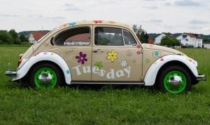 VW Beetle with the word 'Tuesday' over it