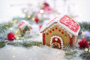 a gingerbread house dressed for Christmas