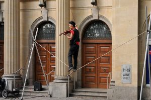 man on a Tightrope AND playing the violin!