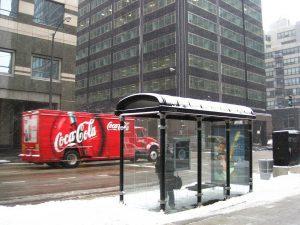 Coca Cola truck driving down a street