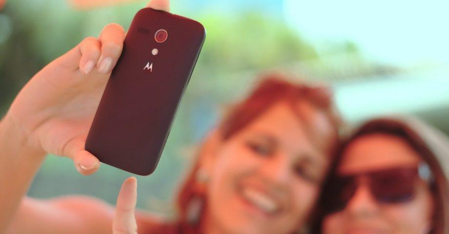 two friends taking a selfie for social media