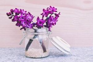 a flower jar with purple flowers