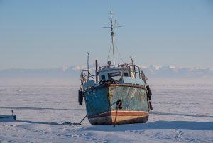 A boat frozen in to Lake Baikal, Siberia