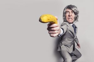 Man pointing with a banana